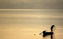 fisherman-romania-dawn.jpg?itok=04-EYiLc